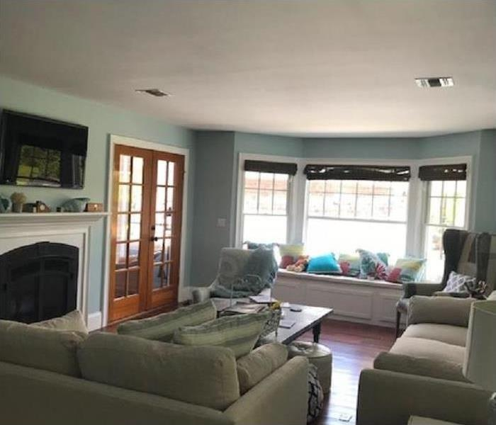 same room, new ceiling and furniture back in place