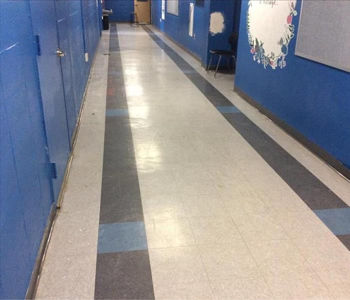 The corridor is dry, cleaned, no sign of water intrusion