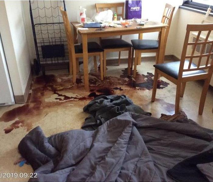 kitchen with blood on a tile floor