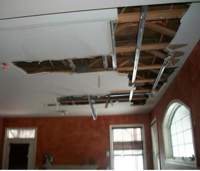 Exposed attic from removed and damaged ceiling material
