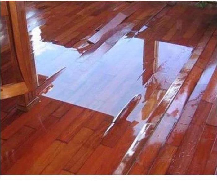 soaked and water damaged hardwood floor boards