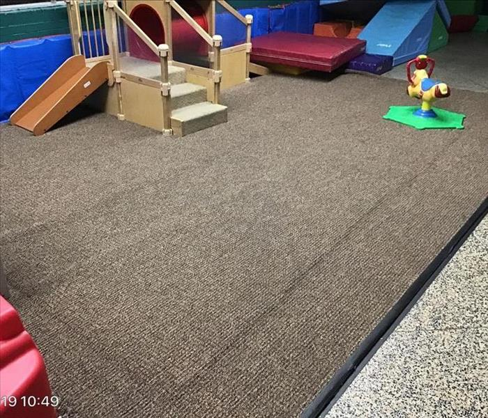 wet carpet in a daycare center